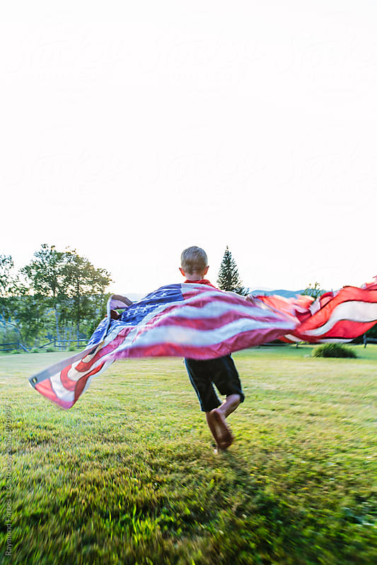 Old Glory on a hill by Raymond Forbes LLC for Stocksy United