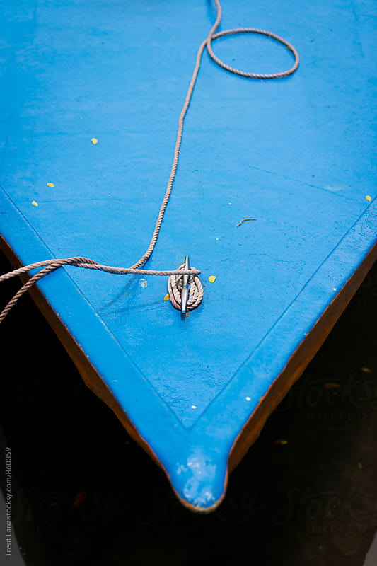 Close-up of rostrum of blue fishing boat with rope by Trent Lanz for Stocksy United