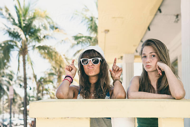 Two Young Women Friends on Spring Break in Miami by Joselito Briones for Stocksy United