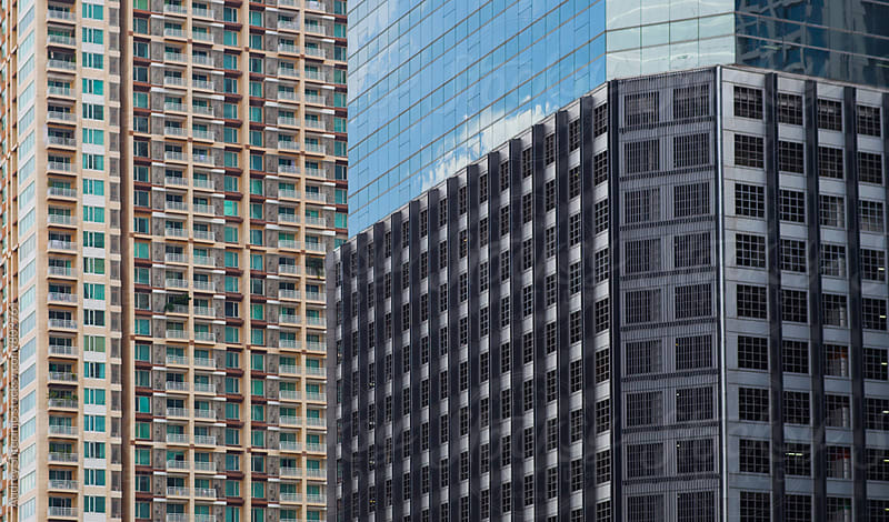 Financial district in Bangkok/various building glass and metal facade patterns by Audrey Shtecinjo for Stocksy United