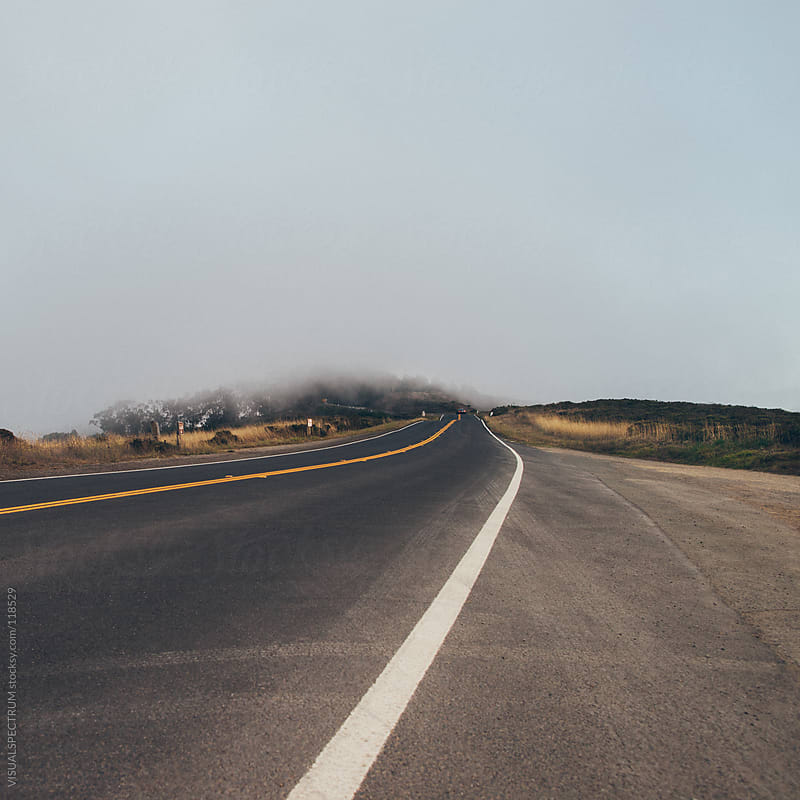 Car Driving on Foggy Road by VISUALSPECTRUM for Stocksy United