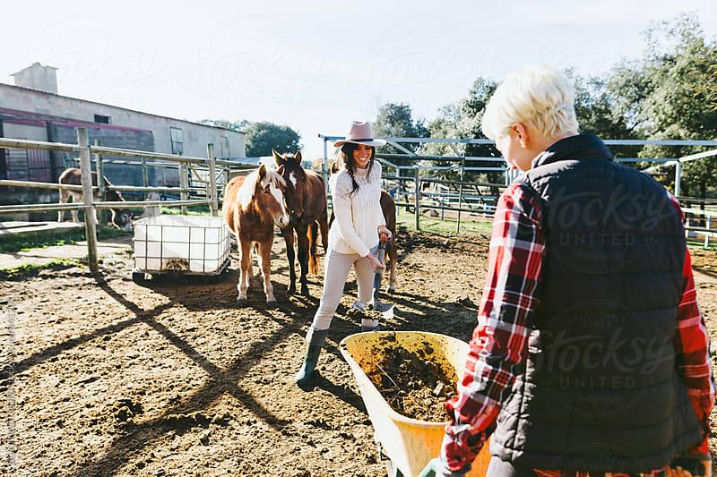 Woman farmers doing farm work. by BONNINSTUDIO for Stocksy United