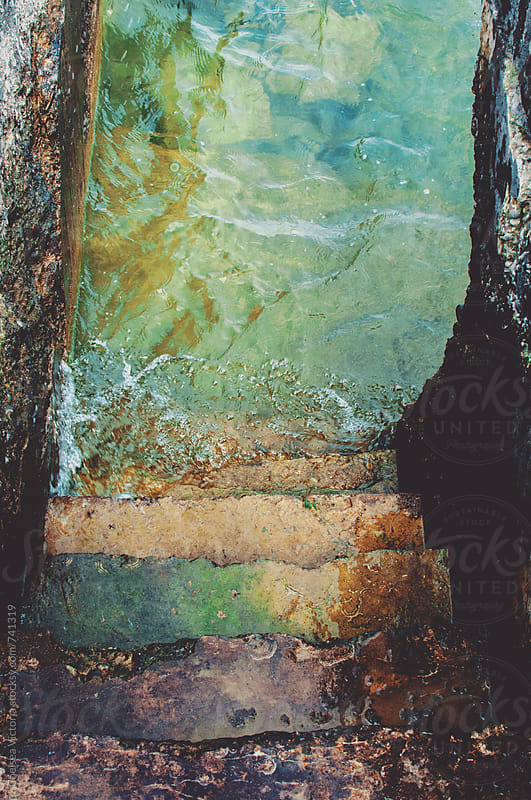 Dirty stairs heading to water by Chelsea Victoria for Stocksy United