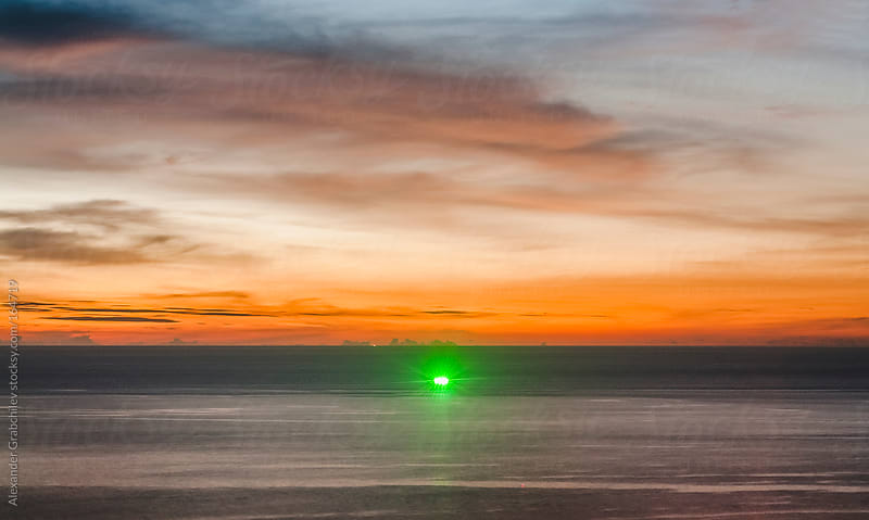 prawn hunter at sunset by Alexander Grabchilev for Stocksy United