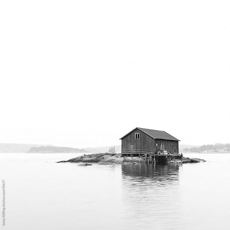 Boat house on an island by Jonas Räfling for Stocksy United