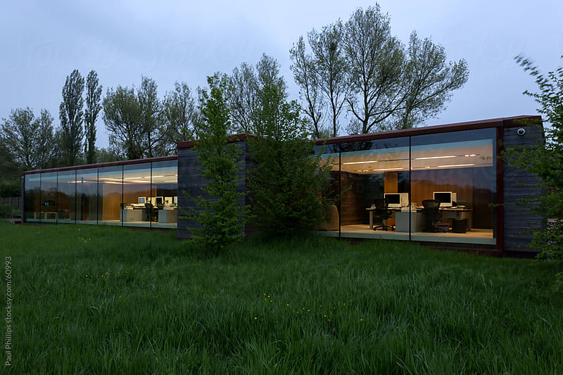 Glass fronted office at twilight by Paul Phillips for Stocksy United