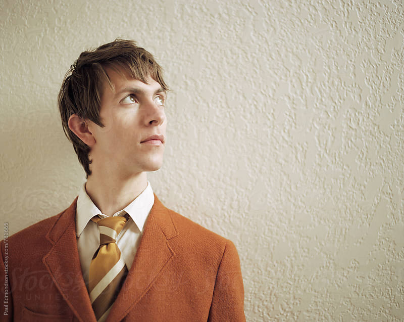 Portrait of hip young man, wearing vintage suit by Paul Edmondson for Stocksy United