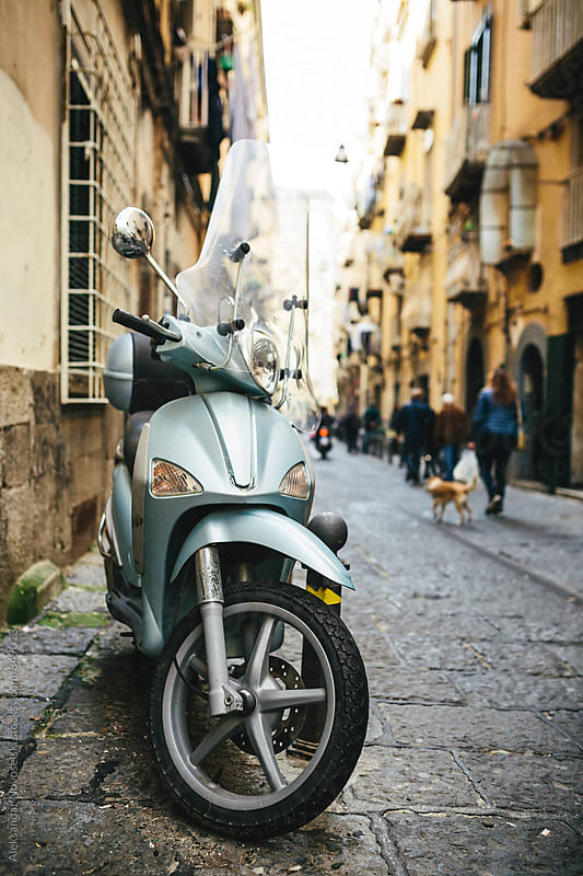 Motorcycle parked in italian street in Naples by Aleksandar Novoselski for Stocksy United