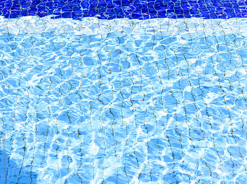 Swimming pool water in close-up by Lawren Lu for Stocksy United