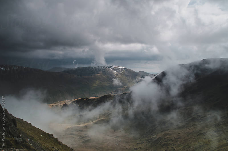 Brooding Storm in the Mountains by Neil Warburton for Stocksy United