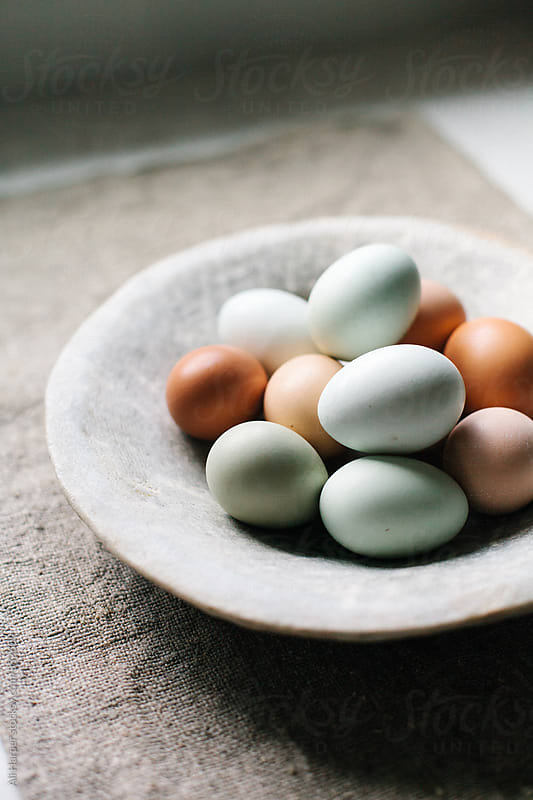 Fresh organic eggs in bowl by Ali Harper for Stocksy United