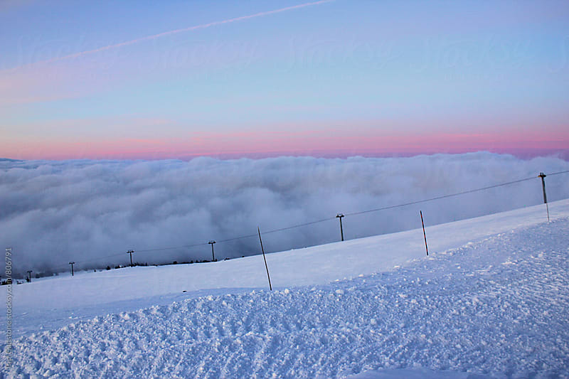 pastel sunrise view from snowy mountain by Tari Gunstone for Stocksy United