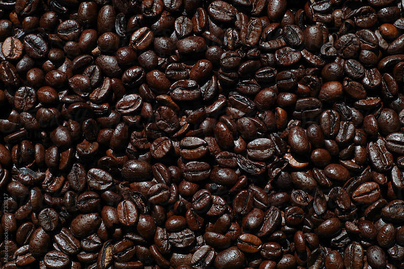Very dark roasted coffee beans by Marcel for Stocksy United
