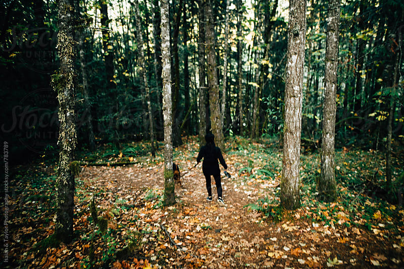 Woman walking through forest by Isaiah & Taylor Photography for Stocksy United