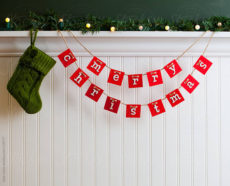 Holidays: Christmas Stocking Hanging By Handmade Sign by Sean Locke for Stocksy United
