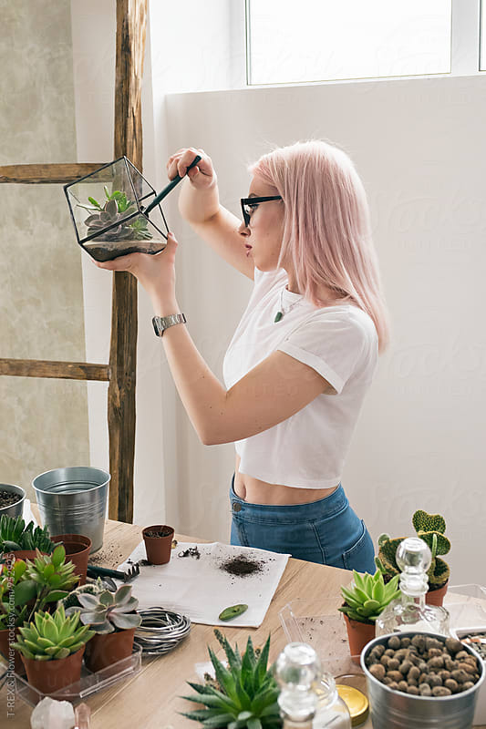 Side view of blonde woman working with succulents by Danil Nevsky for Stocksy United