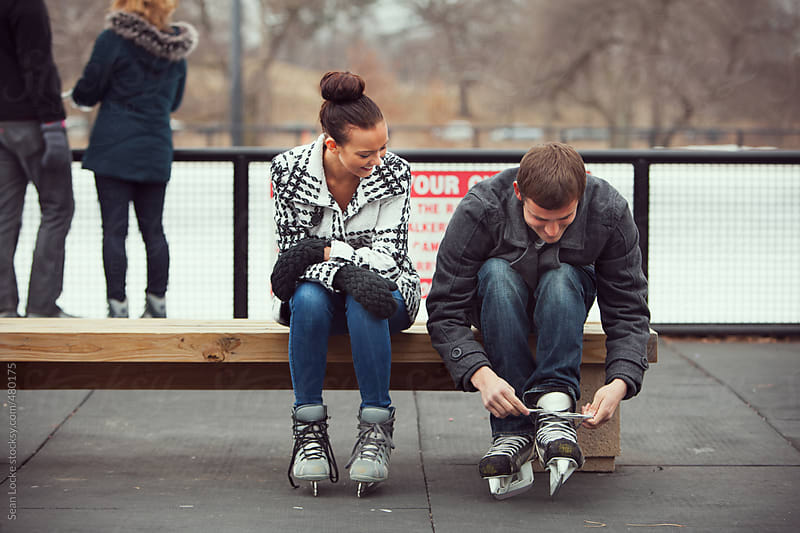 Skating: Woman Waits For Date to Tie Laces by Sean Locke for Stocksy United