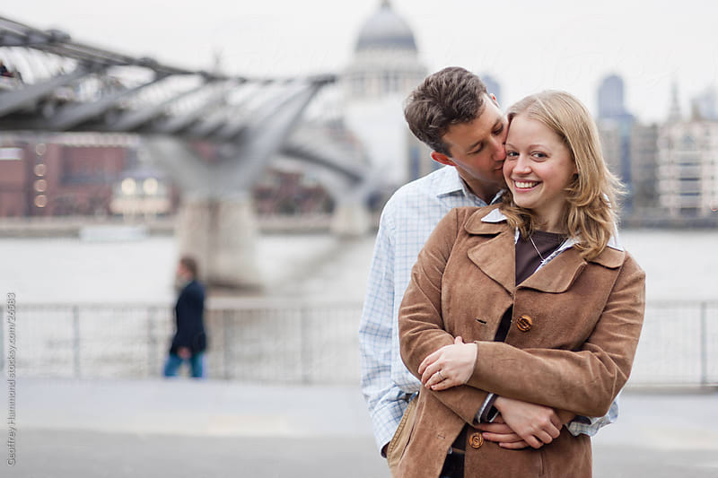 Couple in Love in London, by Millennium Bridge by Geoffrey Hammond for Stocksy United