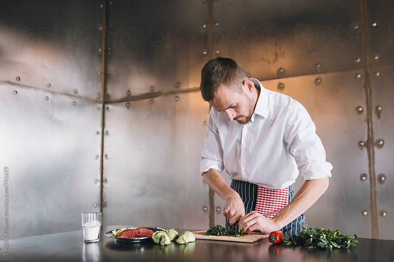 Chef cuts greenery at kitchen by Danil Nevsky for Stocksy United