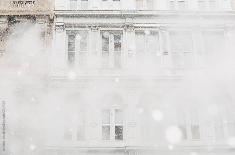 Building exterior during snowstorm. New York City. by Kristin Duvall for Stocksy United