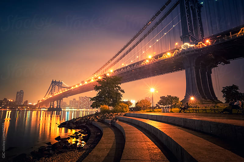 Manhattan Bridge and park by night, NYC by Simone Becchetti for Stocksy United