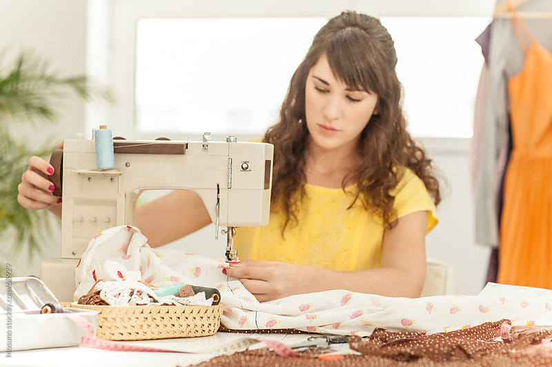 Woman Sewing in a Workshop by Mosuno for Stocksy United