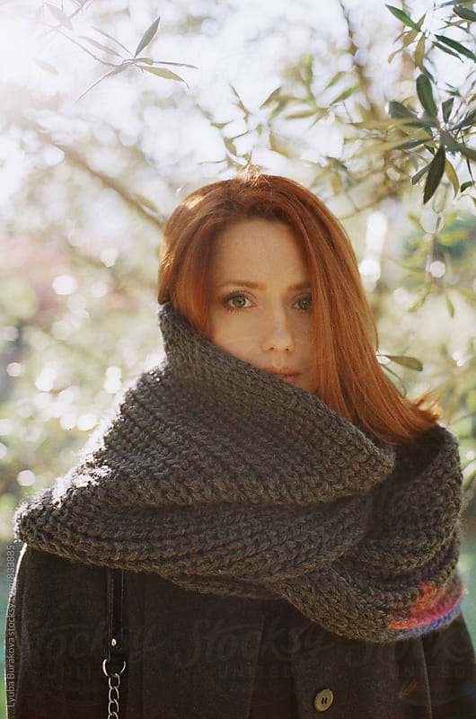 Portrait of a woman wrapped in a scarf by Lyuba Burakova for Stocksy United