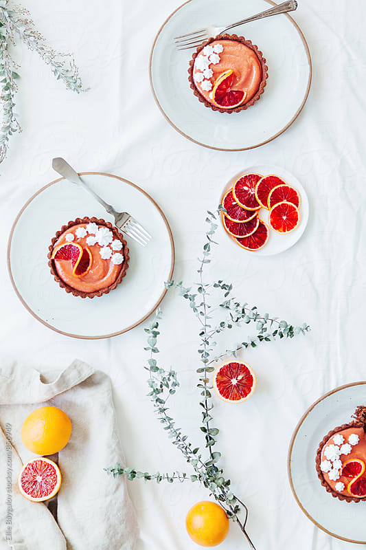 Pretty blood orange tarts by Ellie Baygulov for Stocksy United