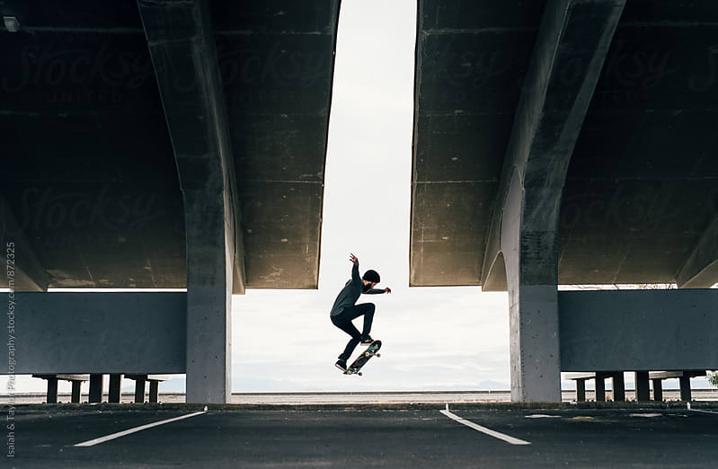 Skater doing a trick by Isaiah & Taylor Photography for Stocksy United