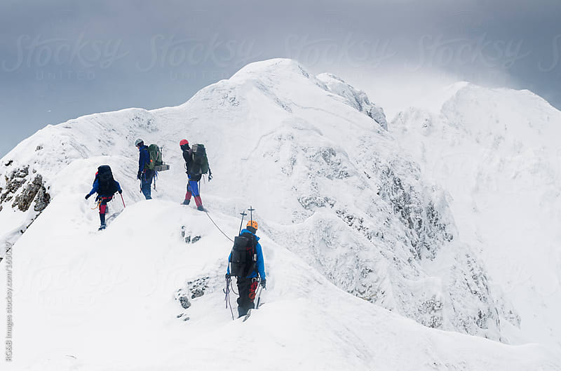 alpinists on the ridge  by RG&B Images for Stocksy United