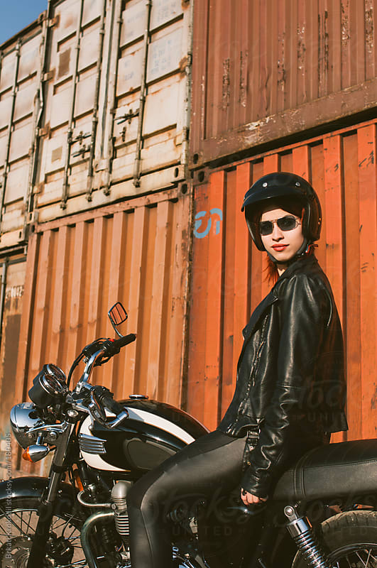 Woman with helmet on a motorbike by Brkati Krokodil for Stocksy United