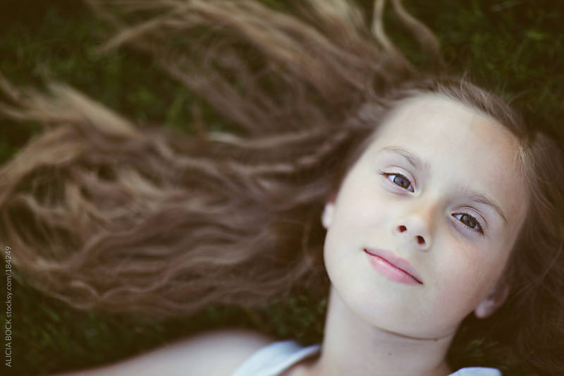 Girl Laying In The Grass by ALICIA BOCK for Stocksy United