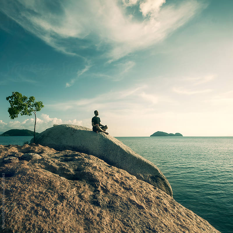 Man Meditating By The Ocean by VISUALSPECTRUM for Stocksy United