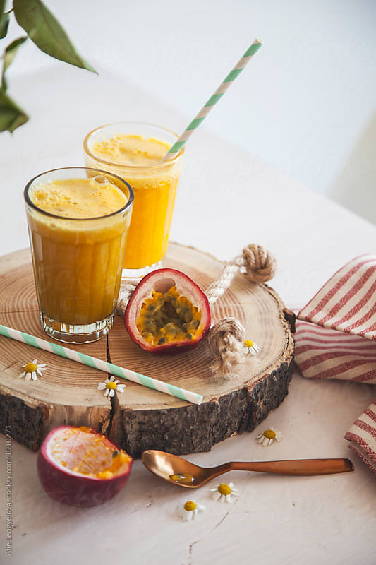 Sweet & Healthy Smoothie from Oranges, Passion Fruit and Banana by Alie Lengyelova for Stocksy United