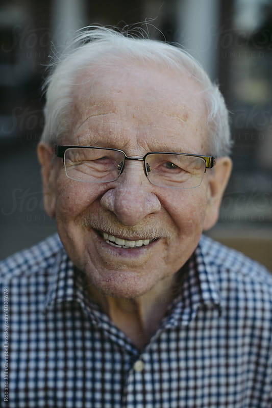 Smiling portrait of senior caucasian man by Rob and Julia Campbell for Stocksy United