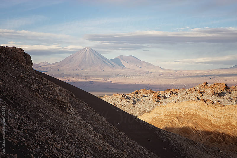 Atacama desert with volcano in the background by Jon Attaway for Stocksy United