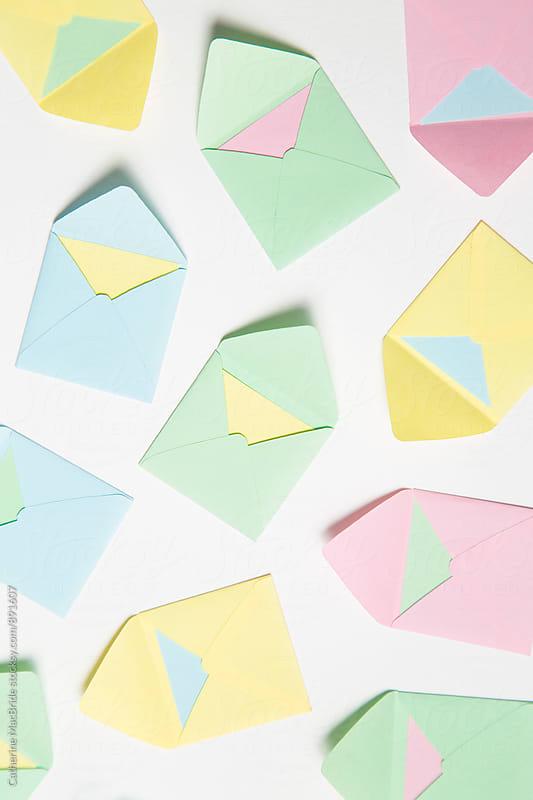 Pastel envelopes on white... by Catherine MacBride for Stocksy United