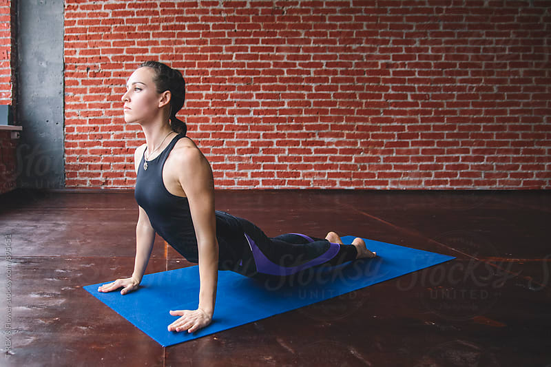 Woman in Upward-Facing Dog Pose by Danil Nevsky for Stocksy United