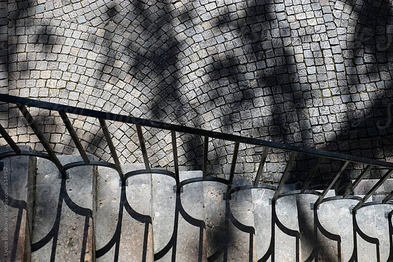 Staircase of stone and paving in sunlight shadows by Lyuba Burakova for Stocksy United