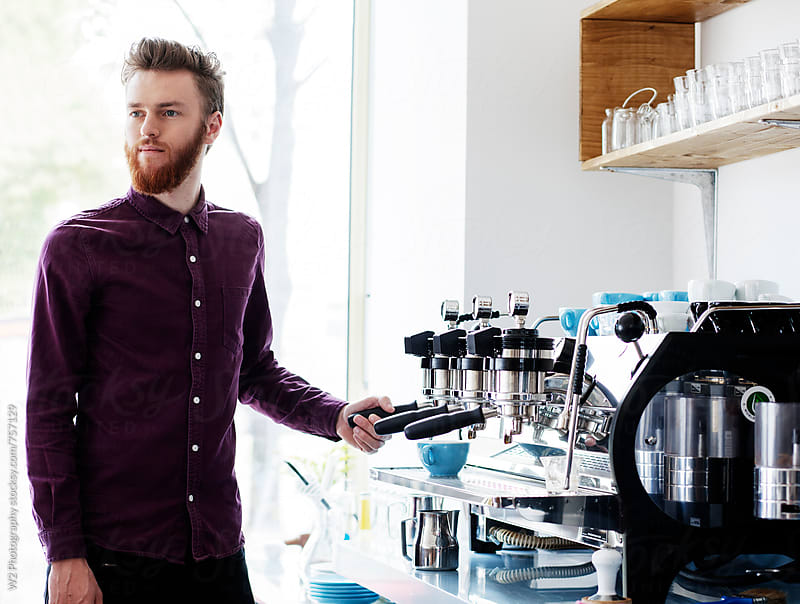 Young man making coffee at a cafe. by W2 Photography for Stocksy United