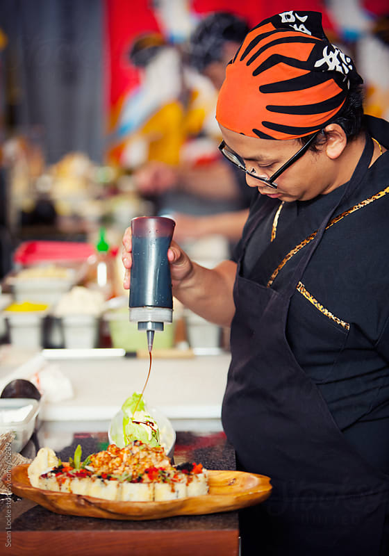 Sushi: Chef Prepares Sushi Roll with Lettuce Wrap by Sean Locke for Stocksy United