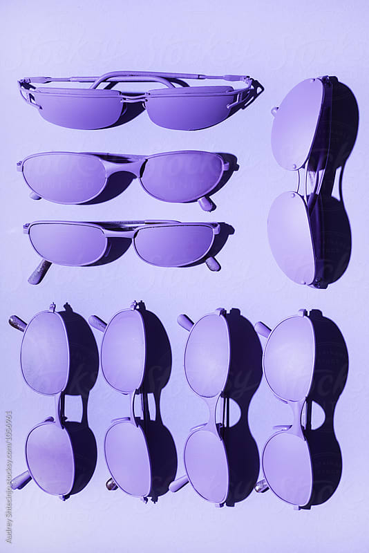 Purple/ violet sunglasses on purple/violet background. by Marko Milanovic for Stocksy United