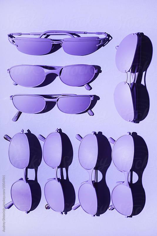 Purple/ violet sunglasses on purple/violet background. by Audrey Shtecinjo for Stocksy United