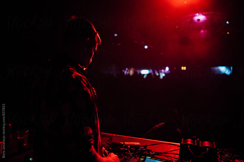 Disc jockey playing a music in the night club by Boris Jovanovic for Stocksy United