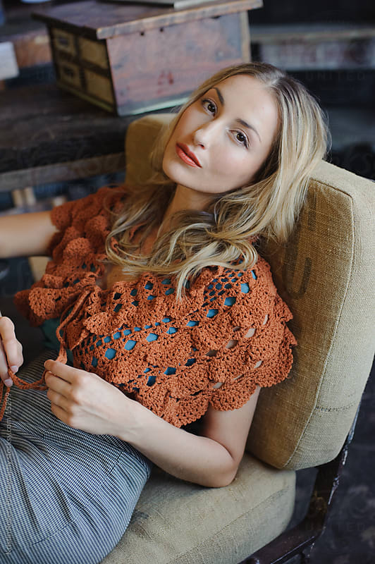 Fashion model Relaxing sitting in antique store by Kristin Rogers Photography for Stocksy United