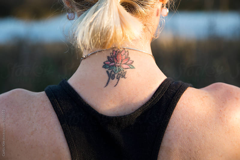 Blonde woman with tattoo on the back of her neck by Curtis Kim for Stocksy United
