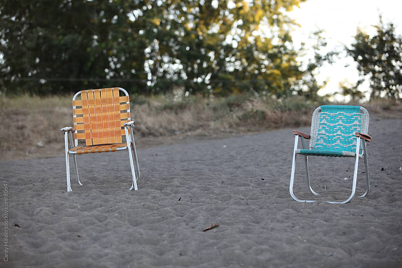 A Pair Of Lawn Chairs Sitting On The Beach During A Vacation by Carey Haider for Stocksy United