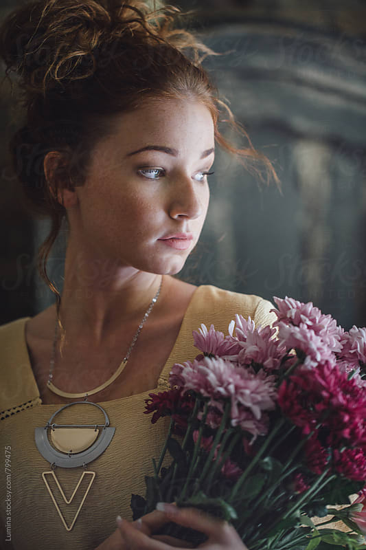 Portrait of a Beautiful Young Woman With a Flower Bouquet by Lumina for Stocksy United