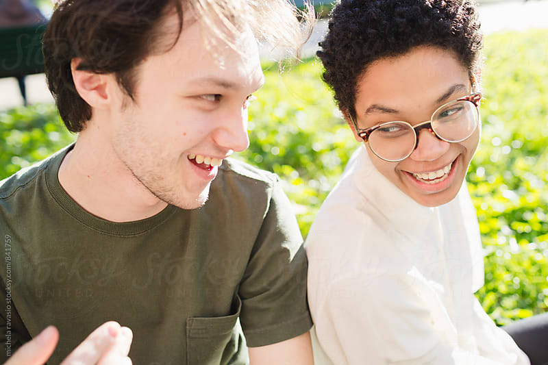 Mixed-race couple having fun together by michela ravasio for Stocksy United