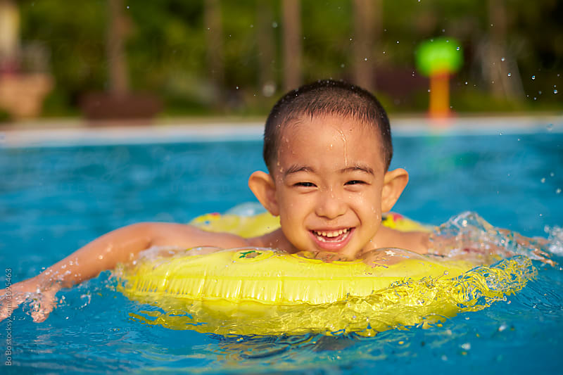 close up of little asian boy in swimming pool by Bo Bo for Stocksy United